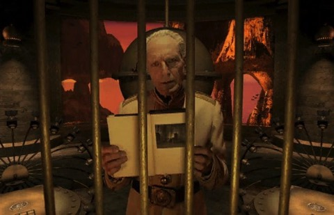 Gehn (John Keston) opens a D'ni trap book in the Cyan computer game Riven: The Sequel to Myst (1997).